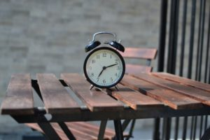 alarm clock on a wooden table