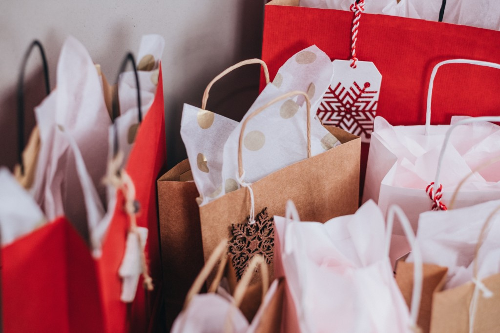 Gift bags with holiday print paper