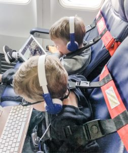Tips for flying with toddlers. Toddlers wearing FAA approved harness on airplane