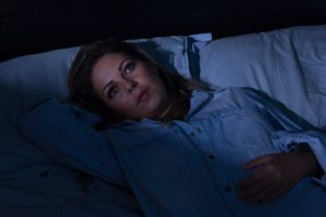 woman wide awake in bed