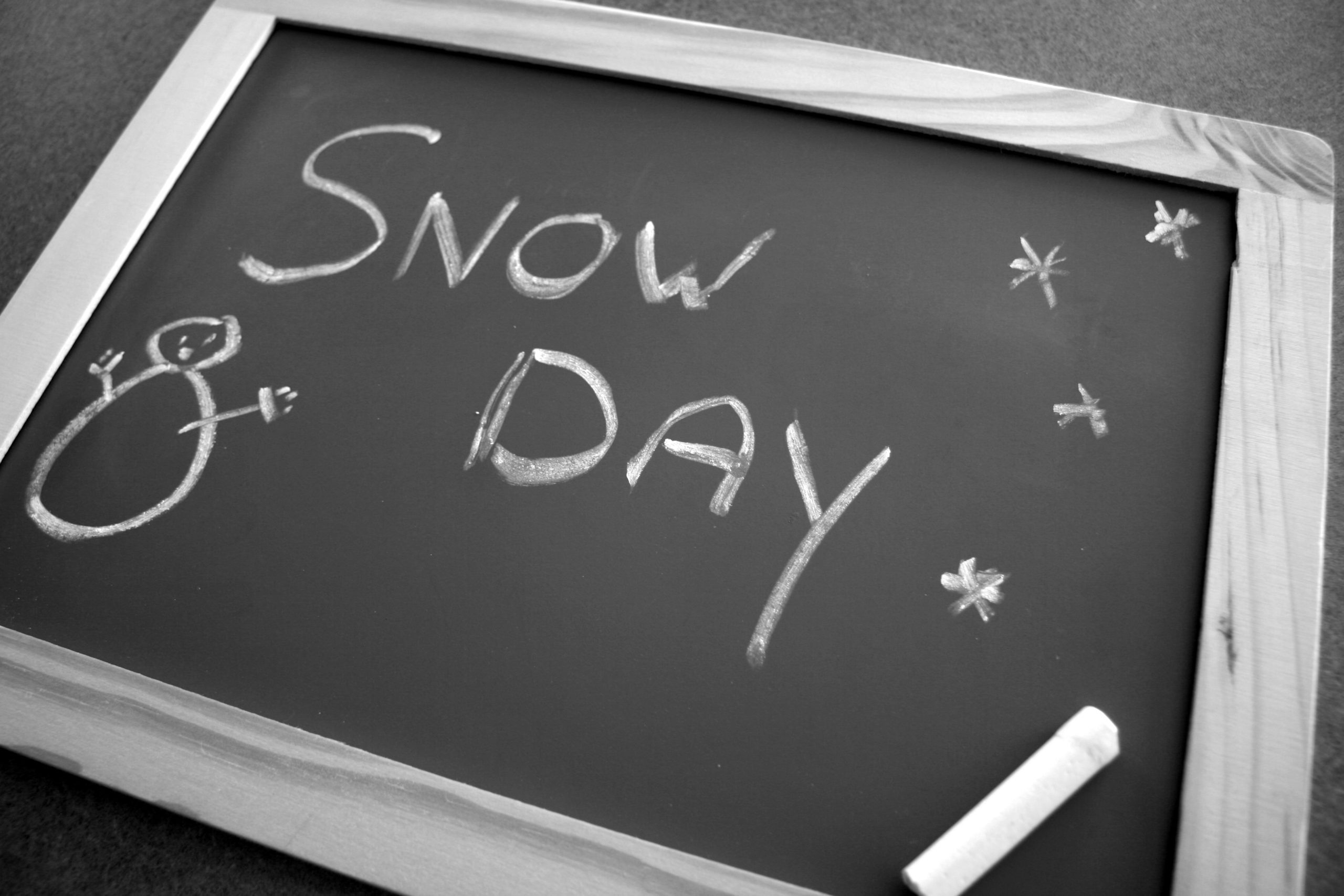 Snow Day written on chalkboard with drawing of snowman