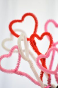 red, pink, and white valentine's day hearts made of pipe cleaners