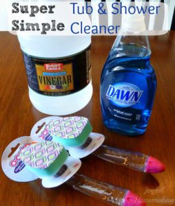 spring cleaning supplies vinegar, soap, and dish wands