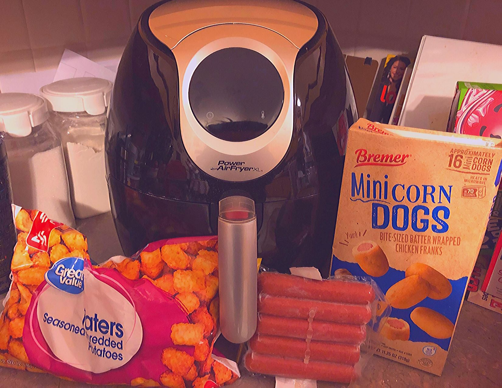 air fryer next to corn dogs and frozen tater tots