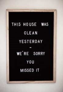 "Black letter board with a spring cleaning quote, ""This house was clean yesterday, we're sorry you missed it."""
