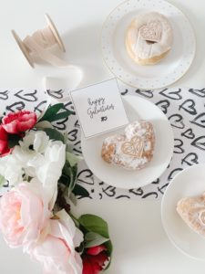Valentine's day spread with flowers and treats