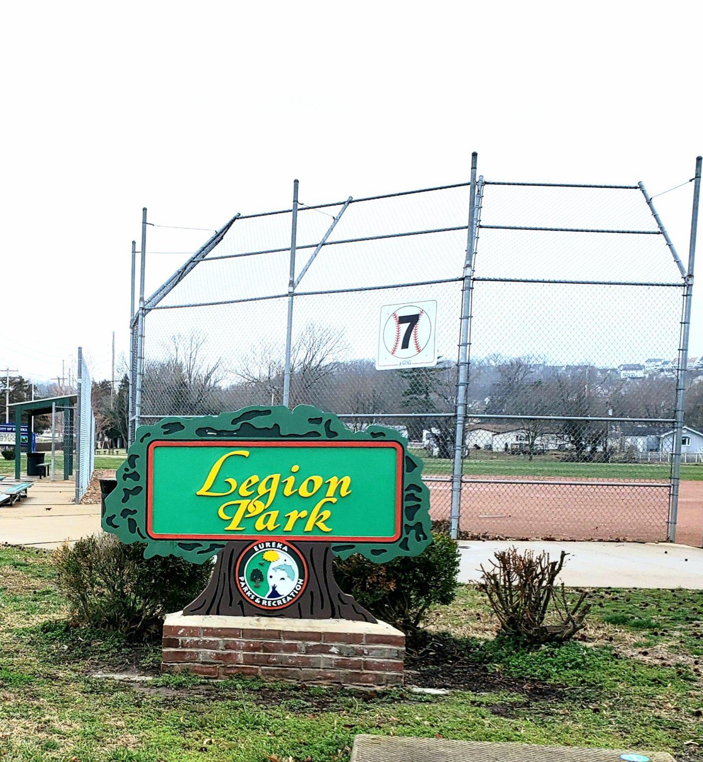 Baseball backstop behind a green Legion Park sign in Eureka