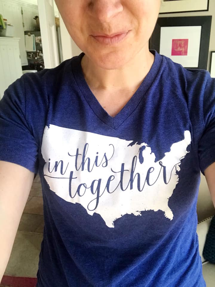 In this together t-shirt with blue writing on a white outline of the united states