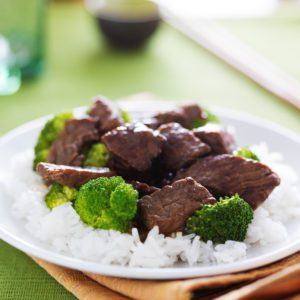 stir fried beef and broccoli over rice
