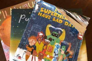 a stack of kids books that relate to foster parenting
