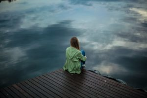 woman sitting on a dock