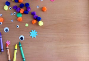 kids craft supplies scattered on a tabletop