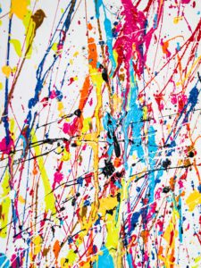 colorful paint splattered on a white background