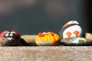 Painted rocks on a wooden table