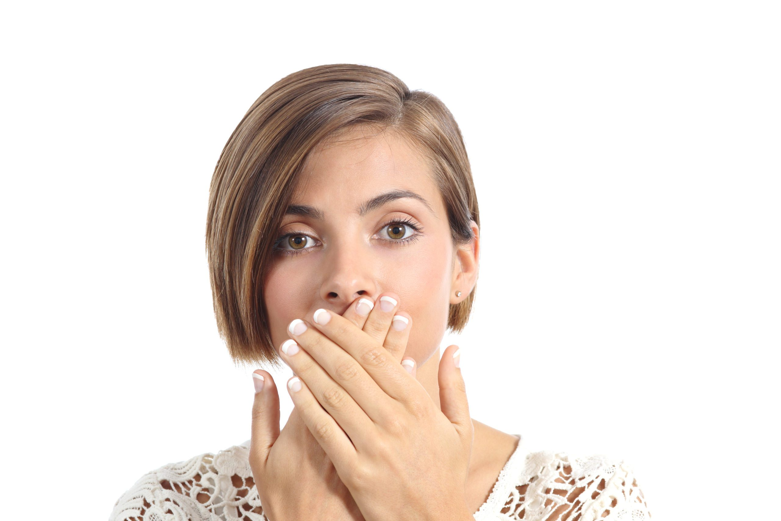 woman covering her mouth because of a cold sore