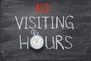 Chalkboard sign saying No Visiting Hours