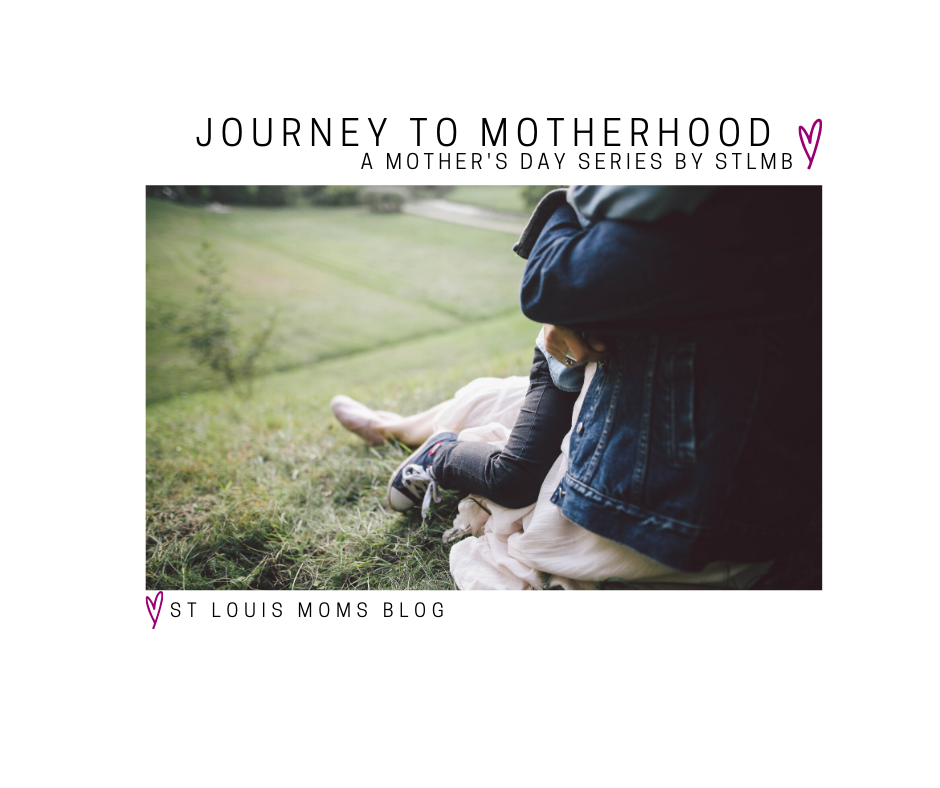 "a close up photo of a child wrapped in her mother's arms as they sit on a grassy hill with the words, ""Journey to Motherhood, A Mother's Day Series by STLMB, St. Louis Moms Blog on it"