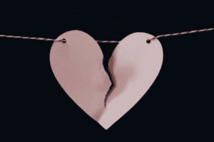 a torn paper heart held together on a string to symbolize race and racial discrimination