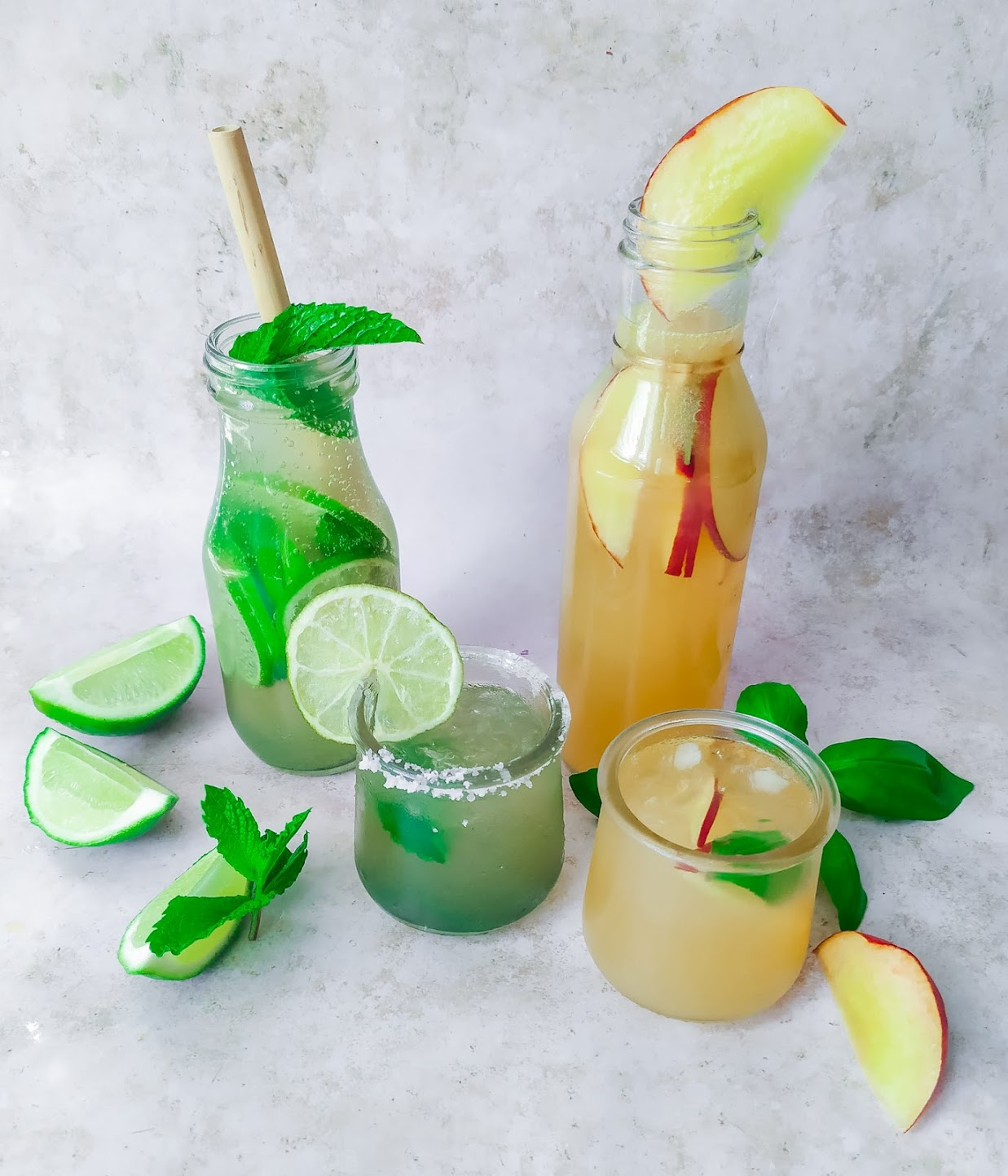fruity mocktails made from limes and peaches on a white background