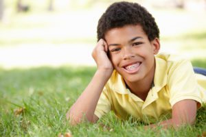 a boy posing in the grass