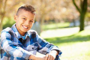 Portrait Of Hispanic Boy In Countryside
