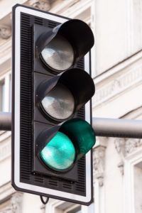 A traffic light with the green light lit