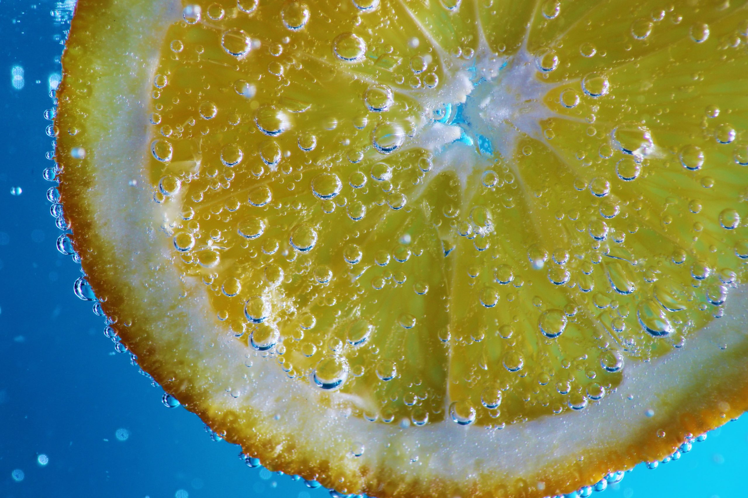 a close up of a lemon wedge in sparkling water
