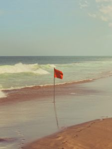 A red flag on a beach