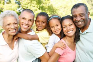 Multi Generation African American Family Having Fun Together In Park
