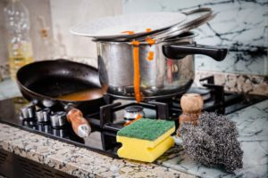 Messy kitchen with dirty cookware