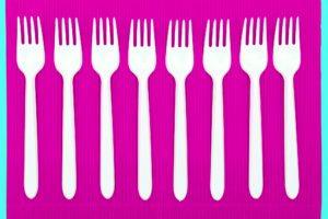plastic forks on a fuchsia napkin on an aqua background
