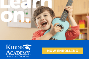a photo of a child strumming a ukulele for Kiddie Academy