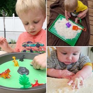 sensory bins full of sand, dinosaurs, and shovels to encourage exploration