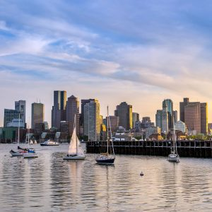 the Boston skyline with sailboats in the water