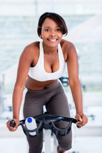 a woman riding a spinning bike
