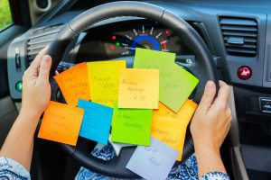 a steering wheel covered with post it notes