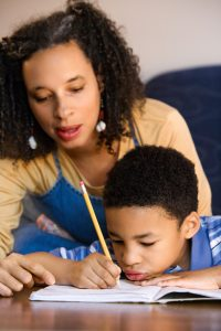 a mom helping her son with homework