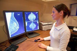 a technician reading a breast scan