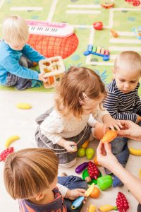 babies and toddlers playing together in daycare