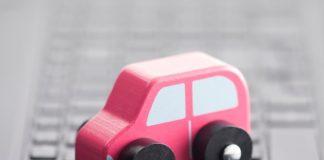 a toy car on a laptop keyboard