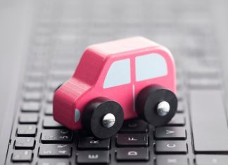 a toy car on a laptop keyboard
