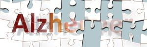 the word Alzheimers on white puzzle pieces, where half of the pieces are missing