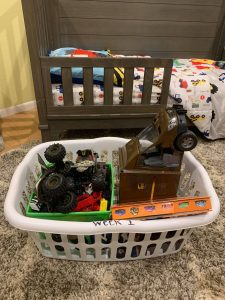 a laundry basket full of toys to move in and out of the house easily when showing your house when moving