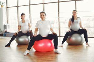 pregnant woman on exercise balls