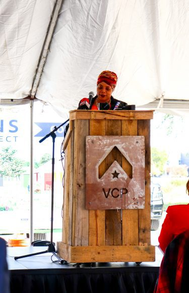 a Senator standing at a podium, dedicating land for the Veterans Community Project