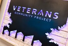 a sign with the words Veterans Community Project