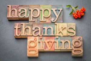 happy thanksgiving written on different colored wooden blocks