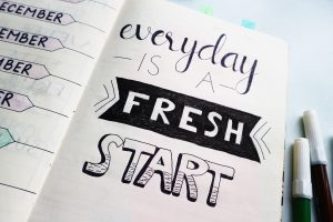 "a planner with the quote, ""everyday is a fresh start"" to remind you to live intentionally"