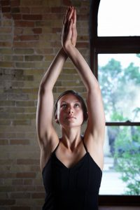 close-up of a woman in a yoga pose