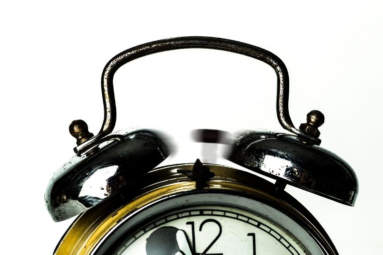 an alarm clock as it rings, waking up